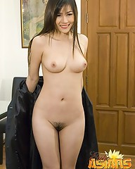 Sexy asian secretary Kanayo stripping and showing her hairy pussy