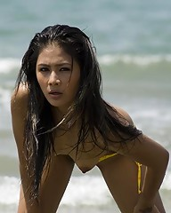 Small breasted Asian Ming posing topless on the beach for you