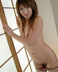 Naughty Japanese Rika showing her curvy ass