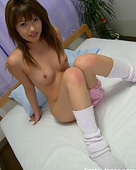 Horny Japanese schoolgirl showing her hairy twat